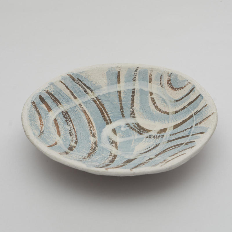 Large shallow slab bowl; white and blue porcelain slip and red oxide; h 6cm; w 26cm