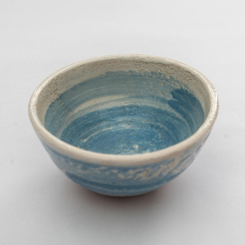 Small thrown bowl; blue and white slip; h 6c; w 12cm