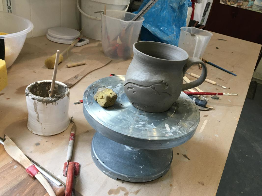My initial forms are mugs to explore the iron rich clay body with use of dolomite glaze in sprigged relief, to yield unique personal vessels with a common theme- everyone has a favourite mug!