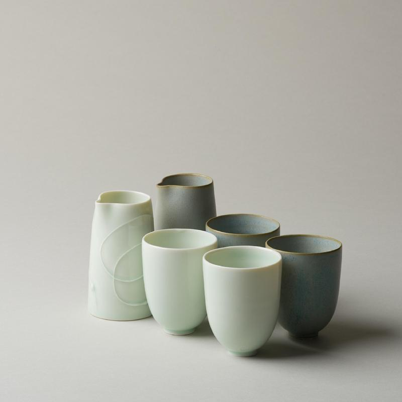 fine porcelain cups and pourers