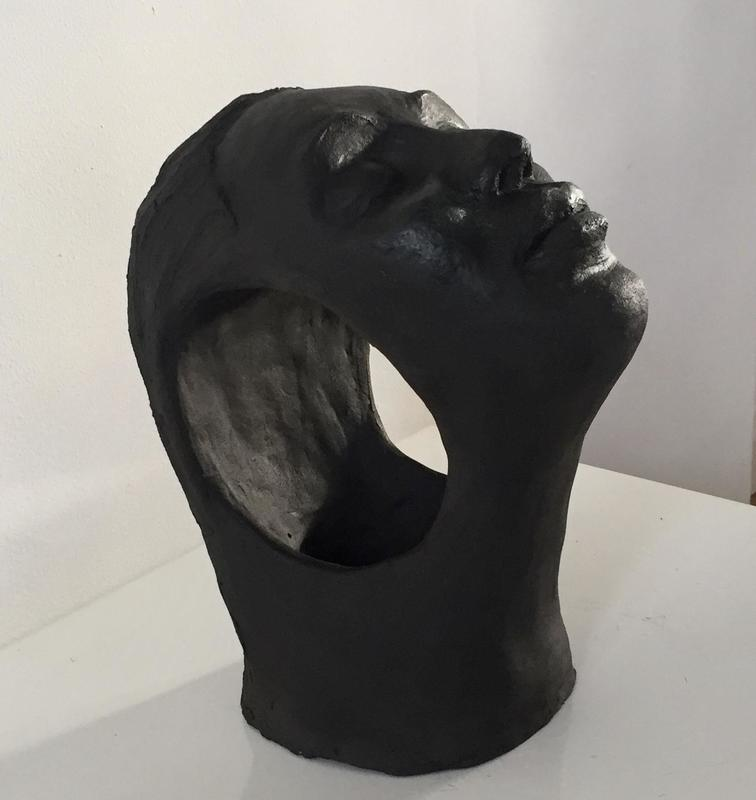 Marguerite.  Portrait in black clay.  Ht 25cm
