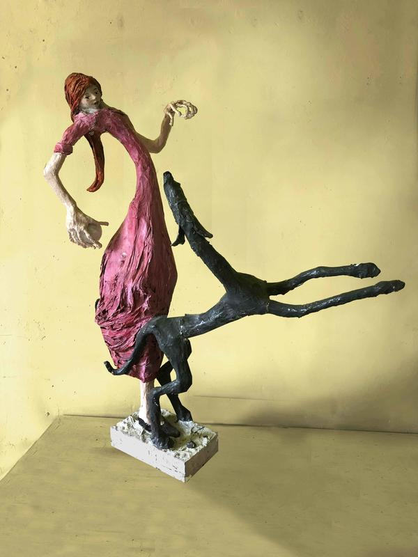 Pink Girl and Dog sculpture - paper wood and glue by Sara Banerji
