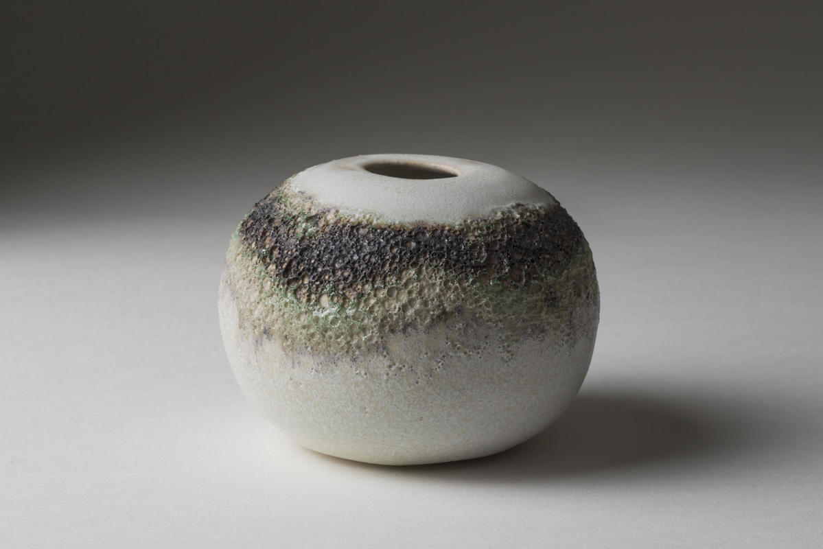 """ball"" with ring of volcanic glaze"