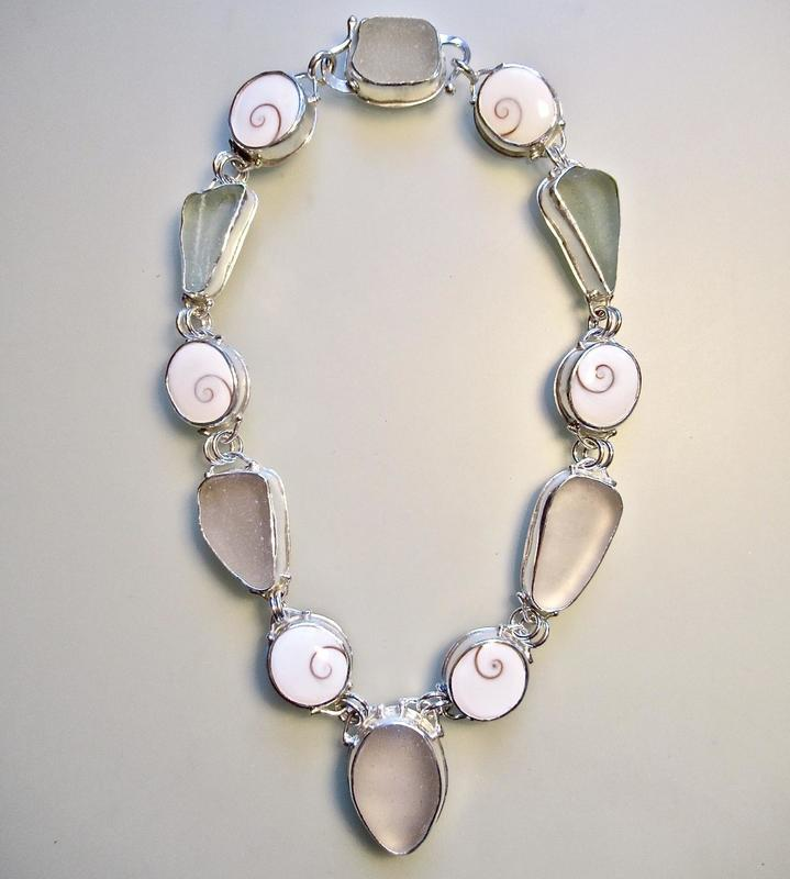 Necklace: beach glass & operculums set in silver with clasp