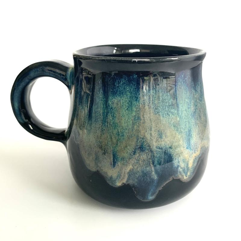 Stoneware mug with layered glazing