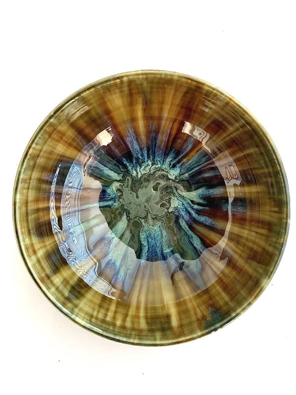 Decorative stoneware bowl with layered glazing