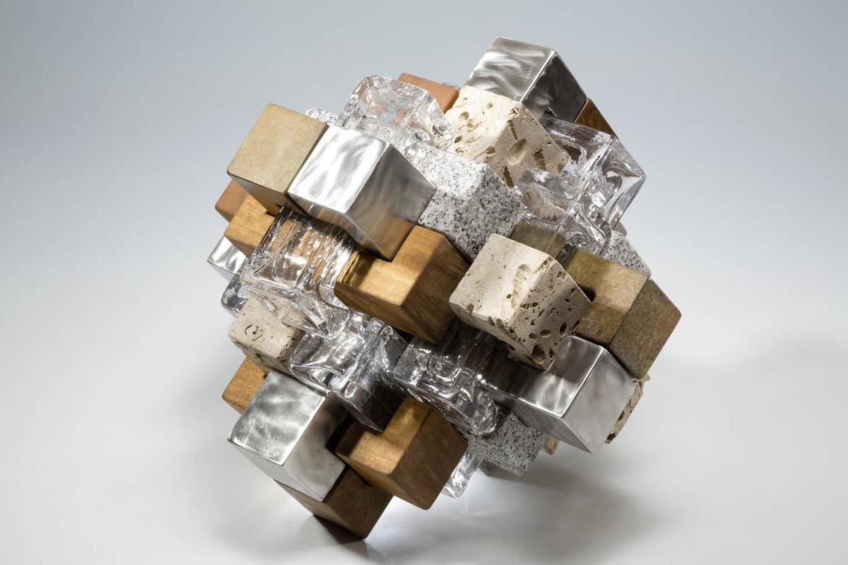 24 pieces, glass, steel, stone bronze, wood 40 x 40 x 49 cm, outrageous to construct