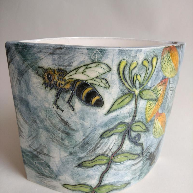 Slab built vase with bee and dragonfly