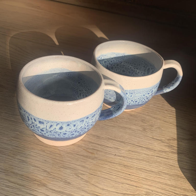 A pair of large stoneware mugs with blue and white glaze £15 each