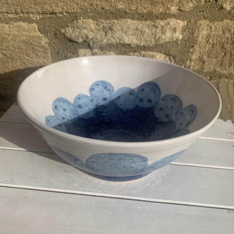 Serving bowl with blue and white glaze, light blue circles £50