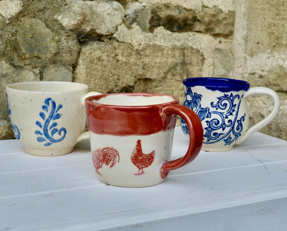 Assorted stoneware mugs with decoration £15 each