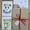 Three Bears Christmas Box, I individually hand-finish each card with silver ink to give a subtle silver sparkle, to highlight the Panda's vintage decorations, the hopeful Polar bear's parcel and Mother Christmas's specs and silver pennies. Before packing them, along with their lovely Kraft envelopes into a Kraft Presentation Gift Box, all tied up with festive woven ribbon. Available from my website, £18.00 for a box of 6 cards