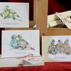 The Three Days of Christmas,The first three days of Christmas, and if you look carefully you can see that the birds are made up entirely of very apt pictures, from pears and turtles to wine and french bread!   The simple cream box contains nine cards, three of each of the designs, along with quality cream envelopes.   The cards are left blank inside for your own message, and presented in their own simple box for easy storage, all tied up with festive Bakers' Twine.  Available from my website for £12.00