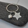 dangly silver star pendant with pearl £52