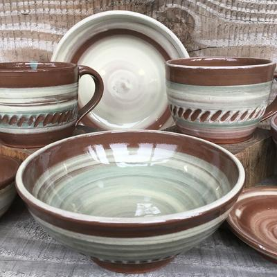 Hand thrown coloured slip decorated earthenware tableware