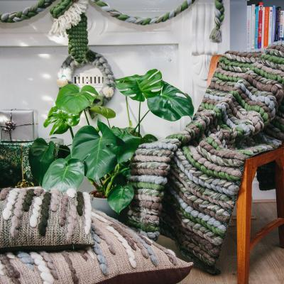 Designer and hand-weaver of richly textured, sustainable interior textiles, lighting and art