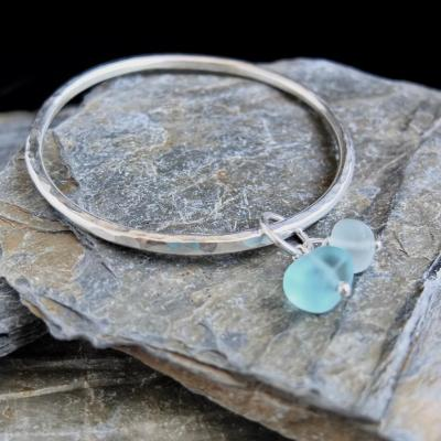 Hammered silver bangle with sea glass £68. For info see www.alisonmorrisjewellery.com