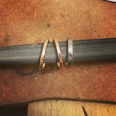 Stacking bands in a variety of precious metals