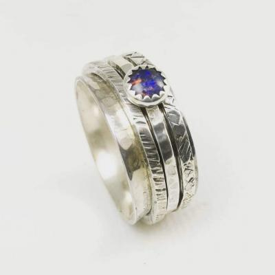 Sterling Silver Spinner Ring set with an opal - from £90