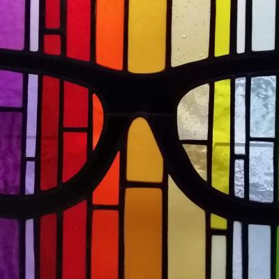 Gospel Lenses, copper foiled stained glass panel