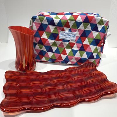 Red fused glass vase and platter with multicoloured washrag