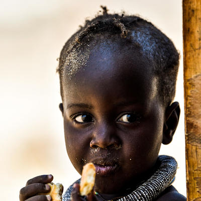 Photo of a young boy who is part of the Herero Tribe in Namibia