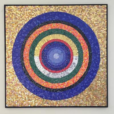 Spheres of the Cosmos.  Smahttps://www.artweeks.org/sites/default/files/2021/galleries/clalti glass, 24ct gold tiles, glass tiles, wood mount.  The creation of the world was often depicted as concentric coloured rings.   In my version I have represented the sky with the outer blue ring, the terracotta ring is earth, green is for flora, gold and silver represent celestial night and day.  I have depicted humans as the red band enveloping the fragile blue planet as a warning of things to come.  79 x 79 x 2.5cm