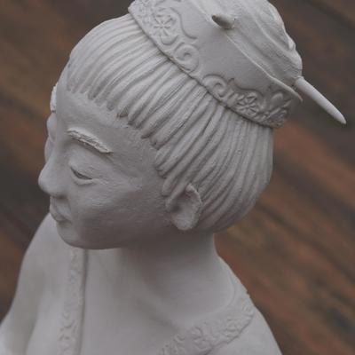 Geisha figure constructed in white stoneware.