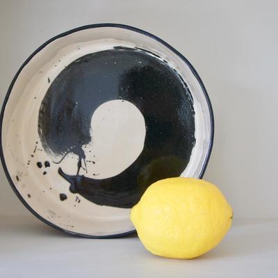 Earthenware drum bowl with black slip decoration