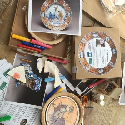 Preparing the broken plate kits which were delivered to participants' homes before the Zoom workshop