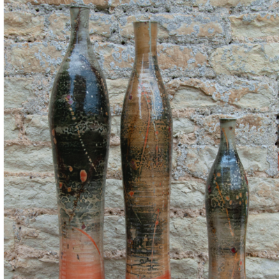 "A trio of bottles - tallest 24""; carbon trap shino"
