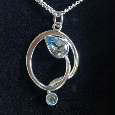 Silver pendant with two blue topaz stones