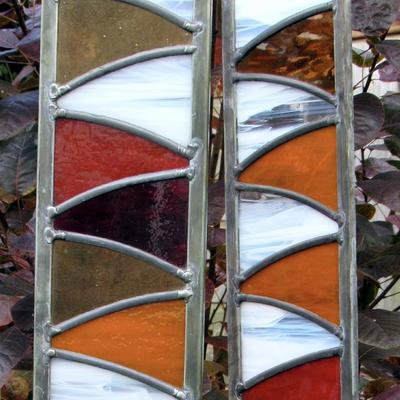 Bright colours and opalescent glass used to create a garden panel