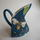 Hand built triangular jug with bee