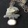 Sea-glass and beach-pebble pendant on handmade sterling silver chain. £85.