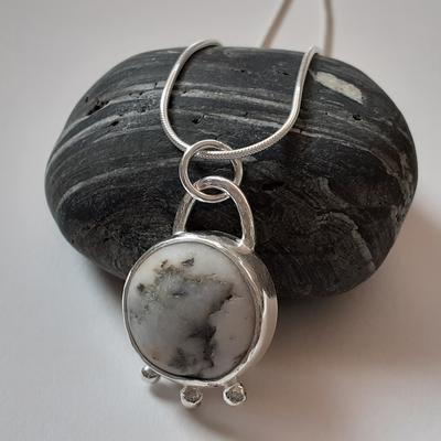 Handmade sterling silver pendant with beach pebble