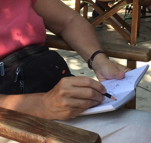 Sketching in a cafe in Pylos, Greece