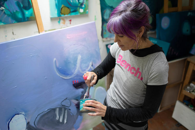 Alison working on a large canvas painting