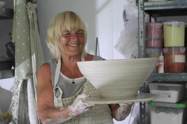 Alison Holmans with a large bowl, made in the Chicken run studio