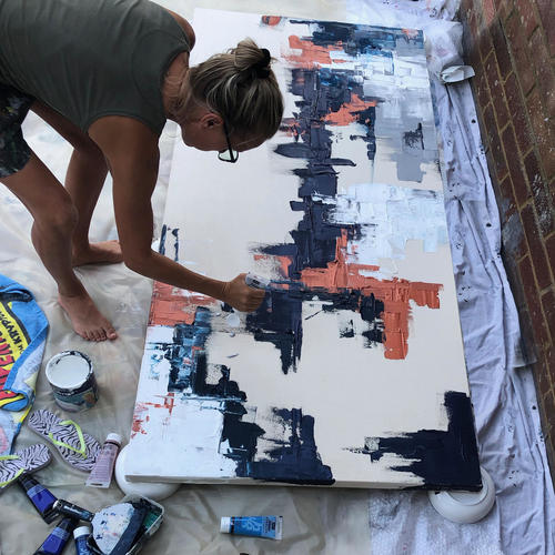 Claudine Hanks working on a large abstract canvas