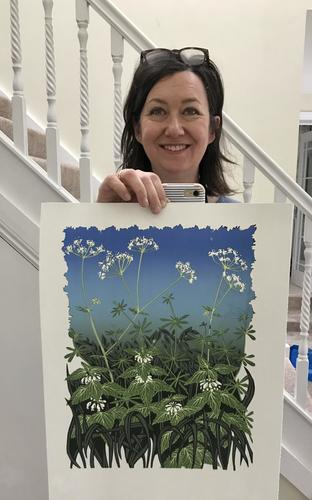 """Gerry Coles holding her print """"Spring Greens"""""""