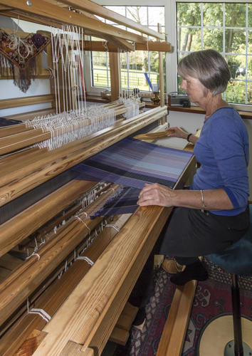 Mary at her floor loom