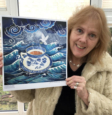 "Jane with a print of her painting ""A teacup for your storm"""