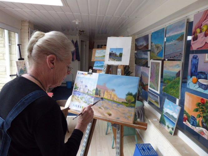 Here I am painting in my lovely studio with some of our paintings already hung