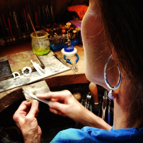 Tess working on silver designs for museum collections