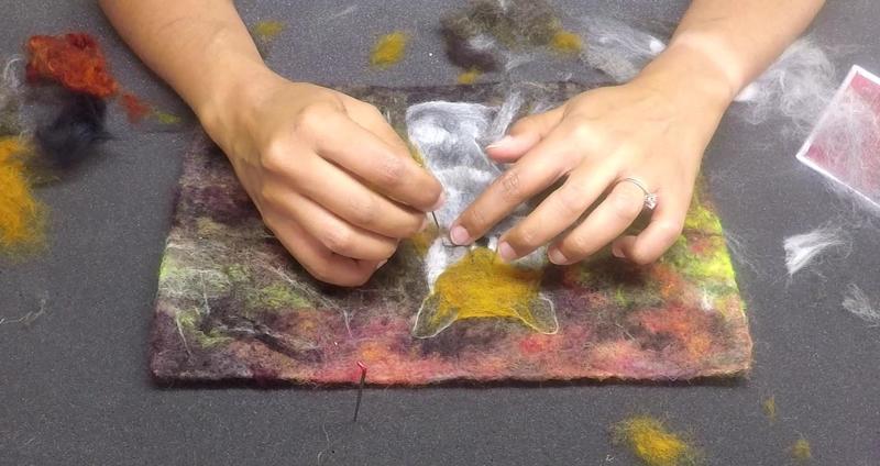 Artist at work needle felting fibre